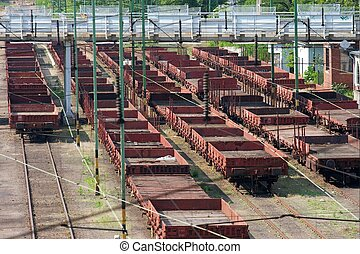 Freight - Railway track system with freight carriages