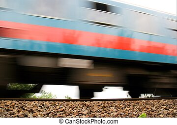 Train - Fast passenger train passing by with motion blur