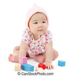 Asian baby girl playing wood blocks - Adorable Asian baby...
