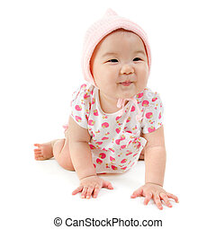 Baby crawling - Six months old Asian mixed race baby girl...
