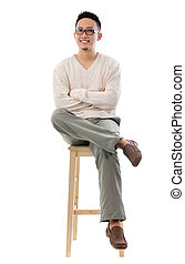 Asian male sitting on a chair - Full body Asian male sitting...