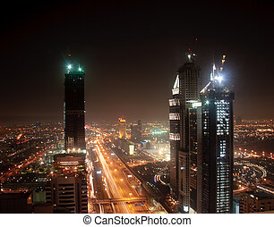 Cityscape of Dubai - Towering city skyscraper blocks in...