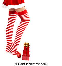 woman legs in color red socks - Woman wearing santa little...