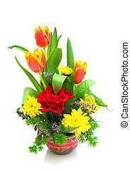 bouquet of flowers in a wooden pot isolated on white...