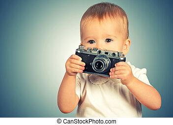 baby girl photographer with retro camera - Beauty baby girl...