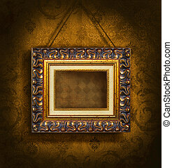 Gold picture frame on antique wallpaper background