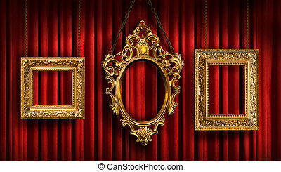 Red drapes with three gold frames