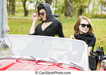 women with dark glasses behind car windscreen - Pretty women...