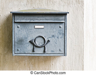 Old mailbox on a building wall, close-up