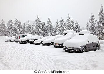 Winter parking - Parking cars covered by a lot of snow