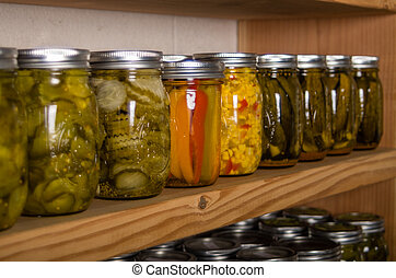 Storage shelves with canned goods - Canned goods on wooden...