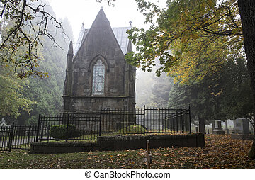 Mausoleum in an Old Pioneer Cemetery in fog - Mausoleum in a...