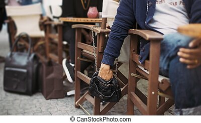 Pickpocketing at the street cafe - Man stealing wallet from...