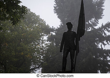 Civil War Memorial, statue of soldier in a graveyard -...
