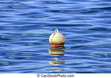 fishing buoy in the blue sea