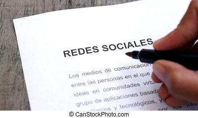 Circling Social Media with a pen - A person Circling Social...