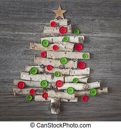 Green christmas tree on wooden background