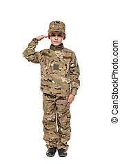 Saluting soldier. Young boy dressed like a soldier isolated...