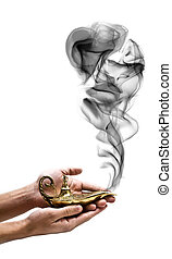 Holding a Magic Lamp - A magic genie lamp on a persons hand,...