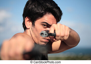 Shooter - A young, robust man, in his 20s with dark hair...