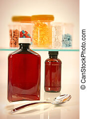 Medicine cabinet - Assorted cough medicines and pills for...