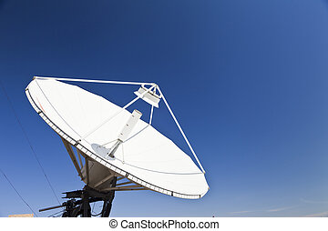Parabolic antenna - The parabolic antenna against the blue...