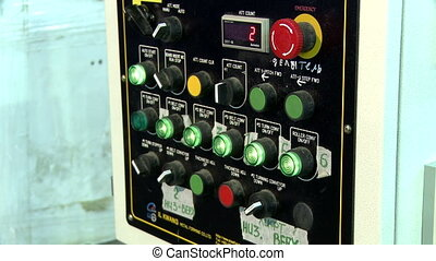 View of buttons and levers on control panel, close-up
