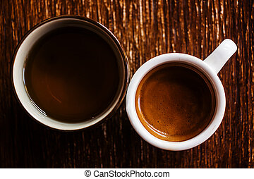 White cup of coffee and tea on wooden background