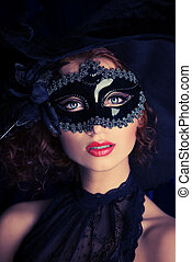 masquerade - Beautiful elegant woman in carnival mask.