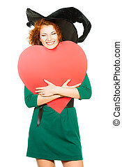 coquette - Charming red-haired witch holding red heart...