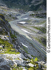 Winding mountain road - Mountain road winding among rocks in...