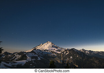 Snowcapped Mount Baker lit by the full moon, Washington state