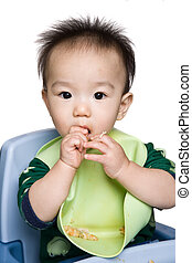 Baby feeding time - A shot of an asian baby during feeding...