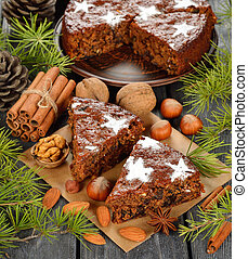 Christmas fruit cake on a gray background