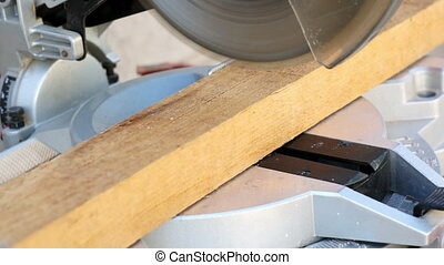 Industrial Miter Saw Cutting Wood - Shallow depth of field...