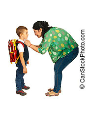Mother prepare boy for school isolated on white background