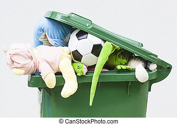 Unwanted toys - A closeup of unwanted toys in a dustbin
