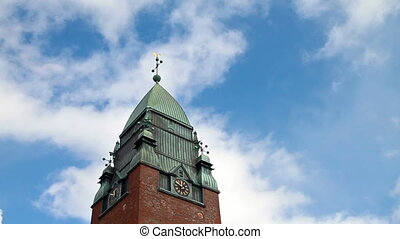 Clouds float above the clock tower Goteborg, Sweden