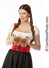 Woman in traditional Bavarian dress - young and beautiful...