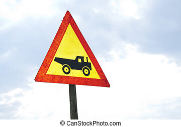 Construction vehicle - sign - Warning road sign showing...