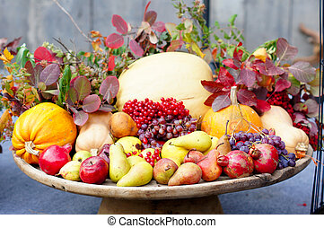 Autumn flowers and fruits in big composition