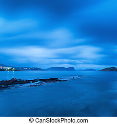 Twilight landscape over beautiful rocky coastline in...