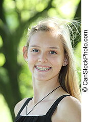 Vivacious young girl with dental braces
