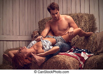 Sexy couple having sex in hayloft. Sexy man with nude torso