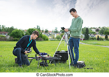 Technicians Working On UAV Spy Drone - Young technicians...