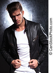 young fashion model in leather jacket