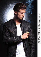 fashion model in leather jacket smoking a big cigar - young...