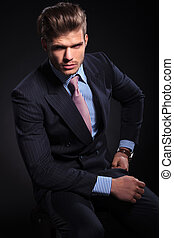 relaxed fashion business man sitting
