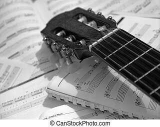 guitar - Head and neck of an acoustic guitar with sheet...