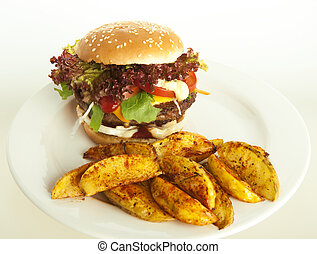 cheeseburger with potato wedges on plate; green and white...